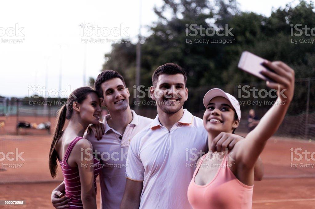 tennis couples taking selfie zbiór zdjęć royalty-free