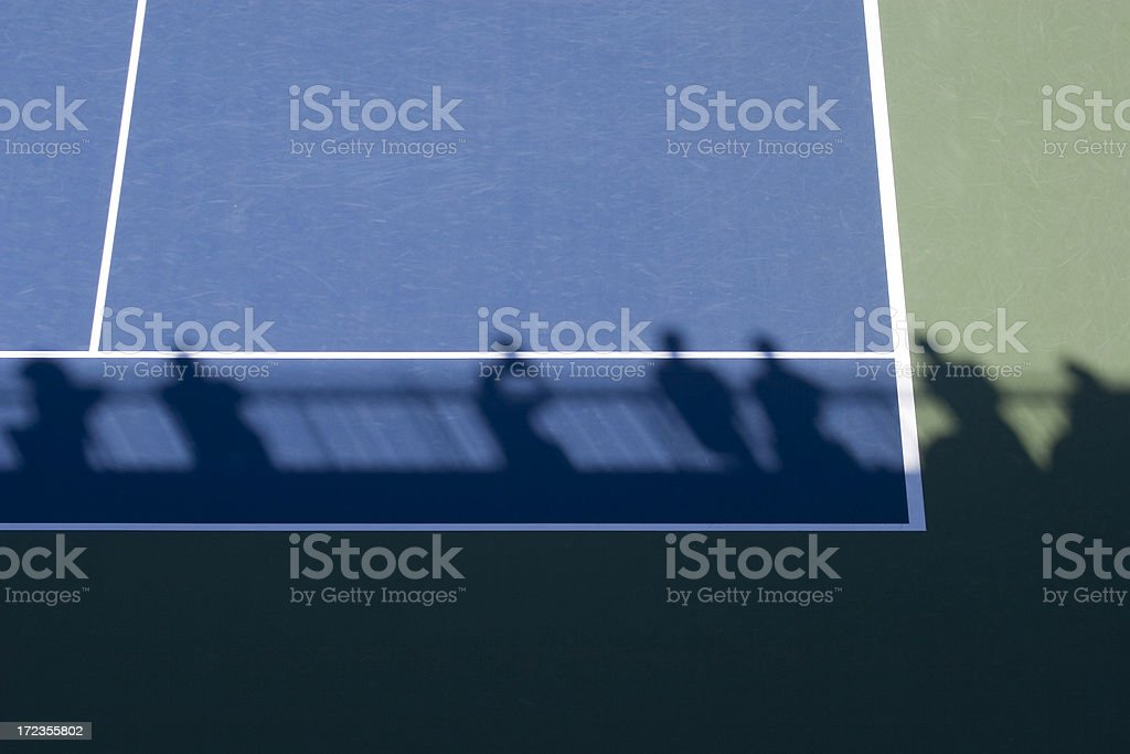 Tennis Court and Shadow of Audience royalty-free stock photo