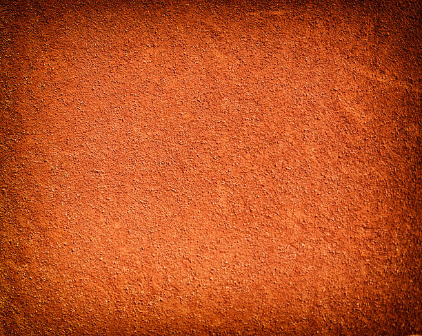 Tennis court background with red clay sand Tennis court background with red clay sand clay stock pictures, royalty-free photos & images