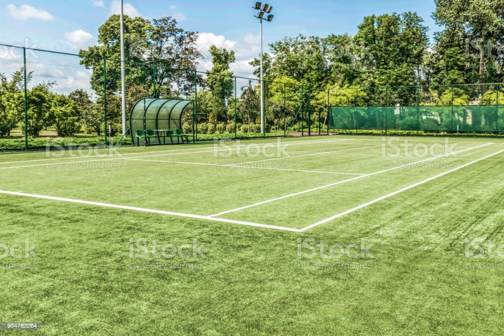 Tennis court in a landscape park against a backdrop of beautiful trees. stock photo