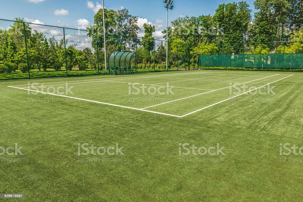 Tennis court in the landscaped park. stock photo