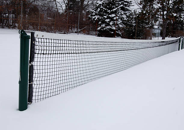 Tennis court in the snow, long view stock photo