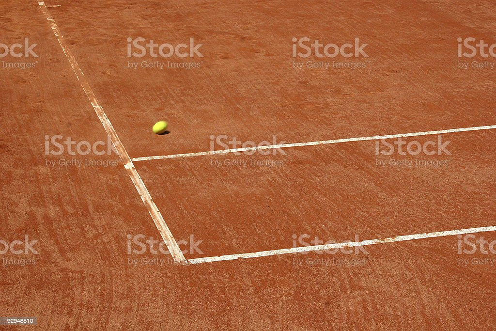 Tennis court with blurred ball on the move royalty-free stock photo
