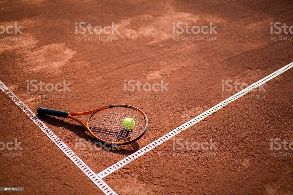 tennis court with tennis ball and racket stock photo