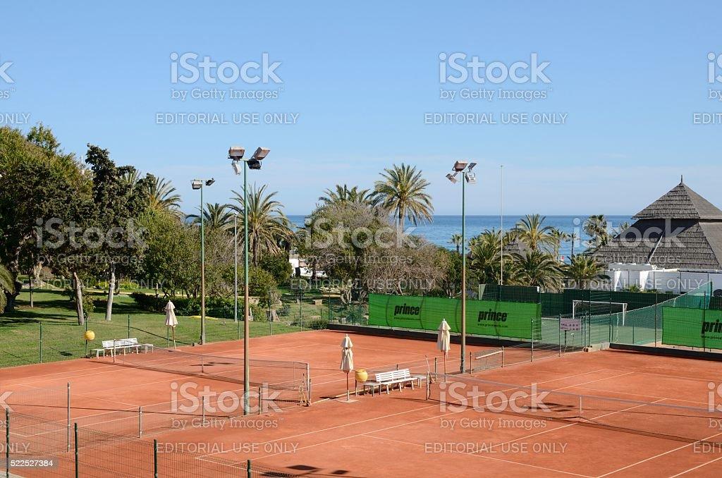 Tennis courts next to the sea stock photo