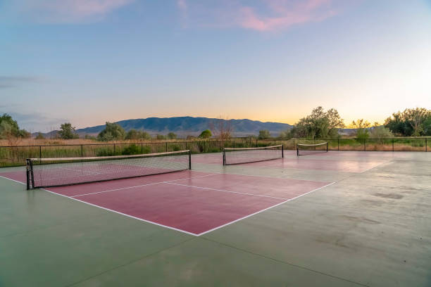 Tennis courts with an amazing view of mountain blue sky and glowing sunset stock photo