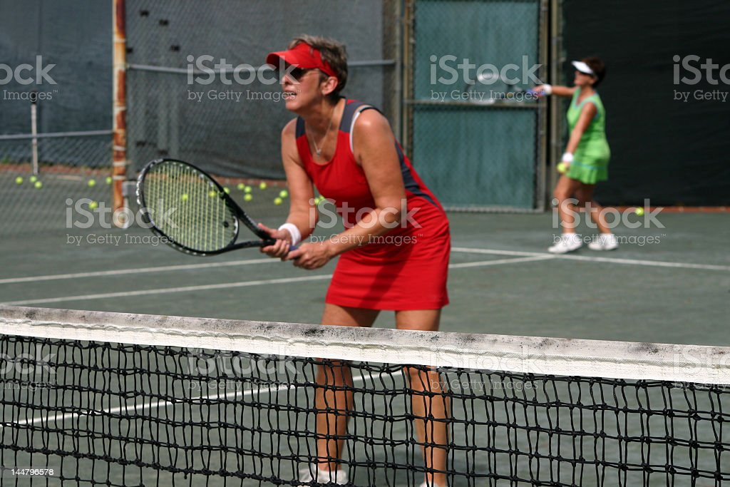 tennis doubles focus on net royalty-free stock photo