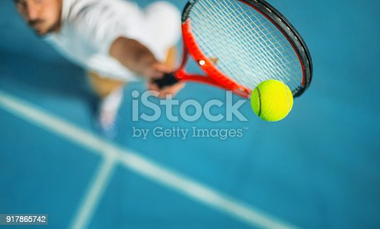1153628111istockphoto Tennis game at night. 917865742
