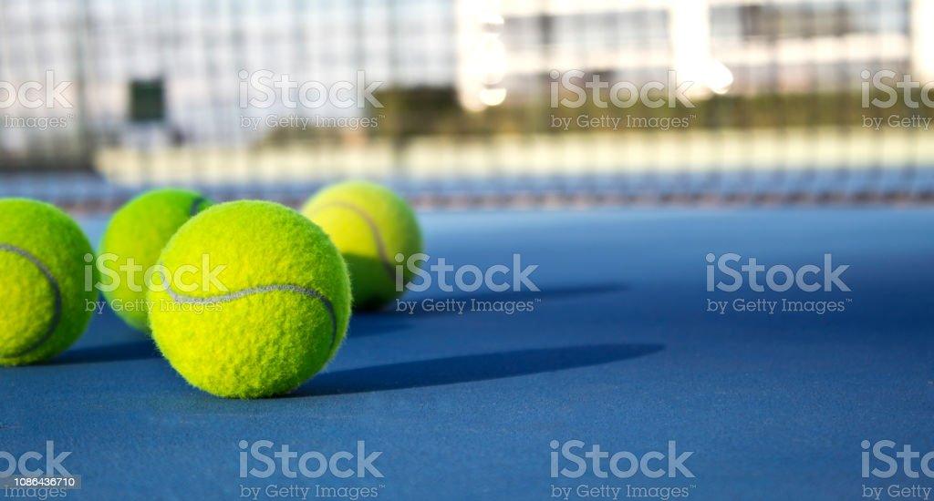 Tennis game. Tennis balls on the tennis court. Sport, recreation...