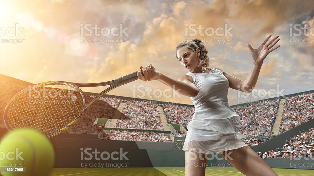 Tennis Girl in Close Up Hitting Ball stock photo