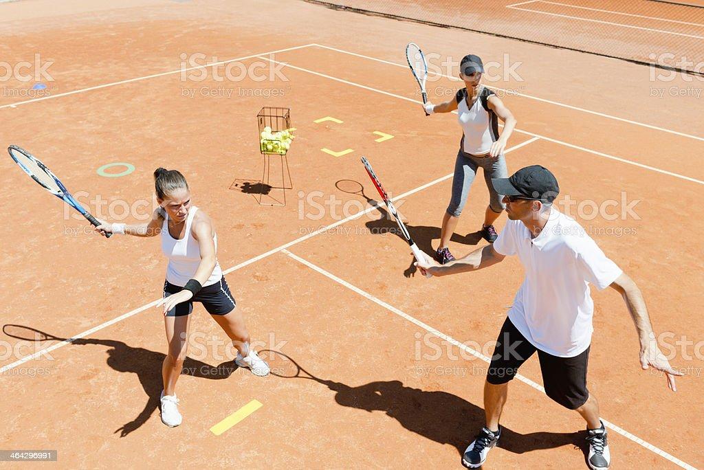 Tennis instructor explaining forehand stock photo