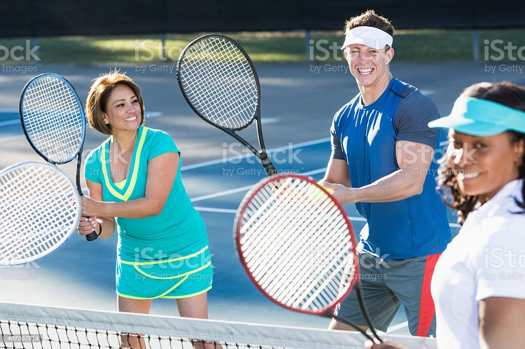 Tennis instructor with group of women stock photo