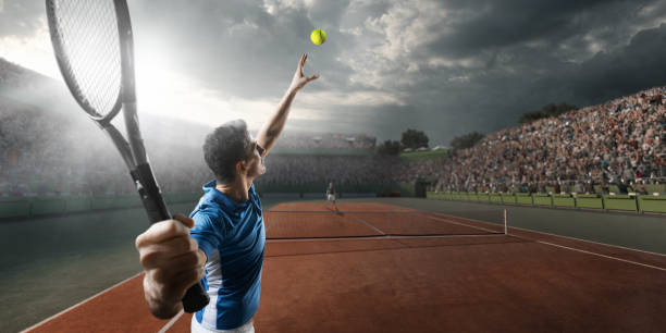 tennis: male sportsman in action - tennis stock pictures, royalty-free photos & images