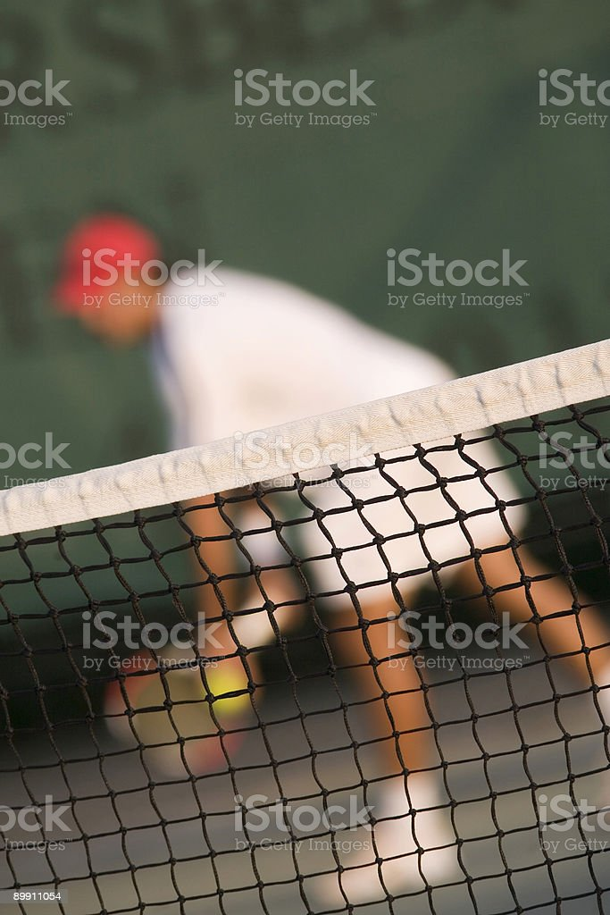 tennis net with a player ready to serve royalty-free stock photo