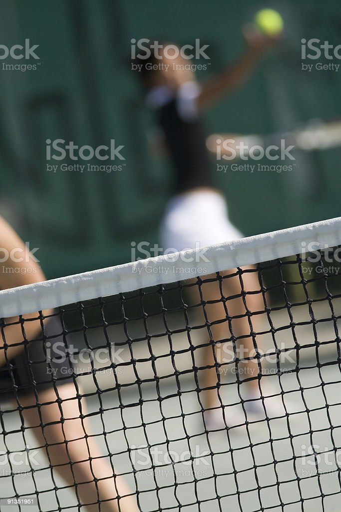 tennis net with two female players royalty-free stock photo