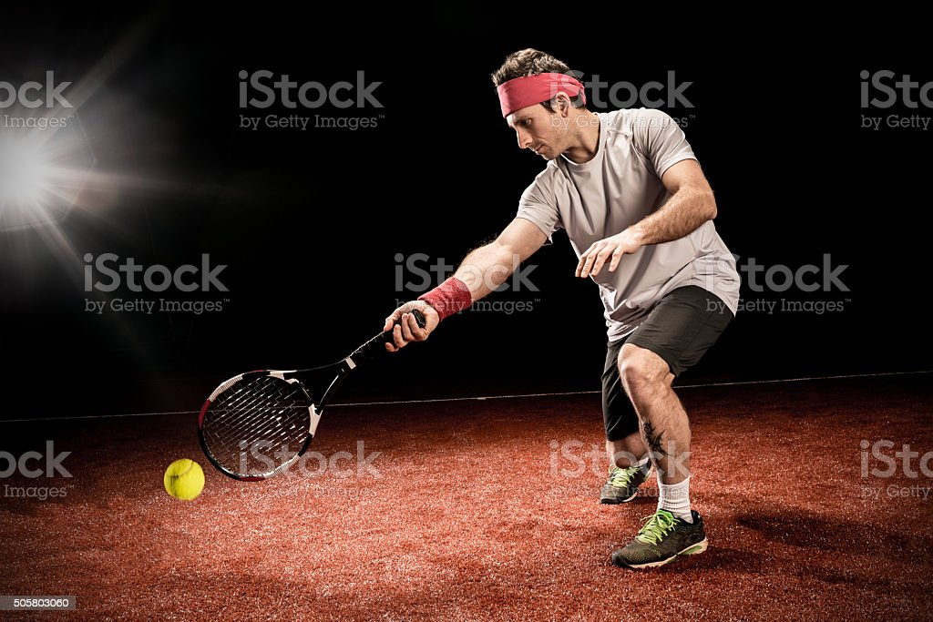 Tennis player action: Low forehand stock photo