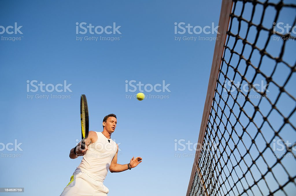Tennis player against the blue sky royalty-free stock photo