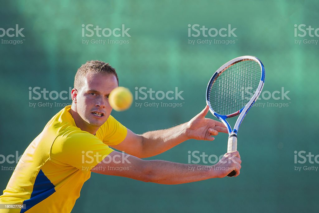 Tennis Player at Backhand Volley royalty-free stock photo
