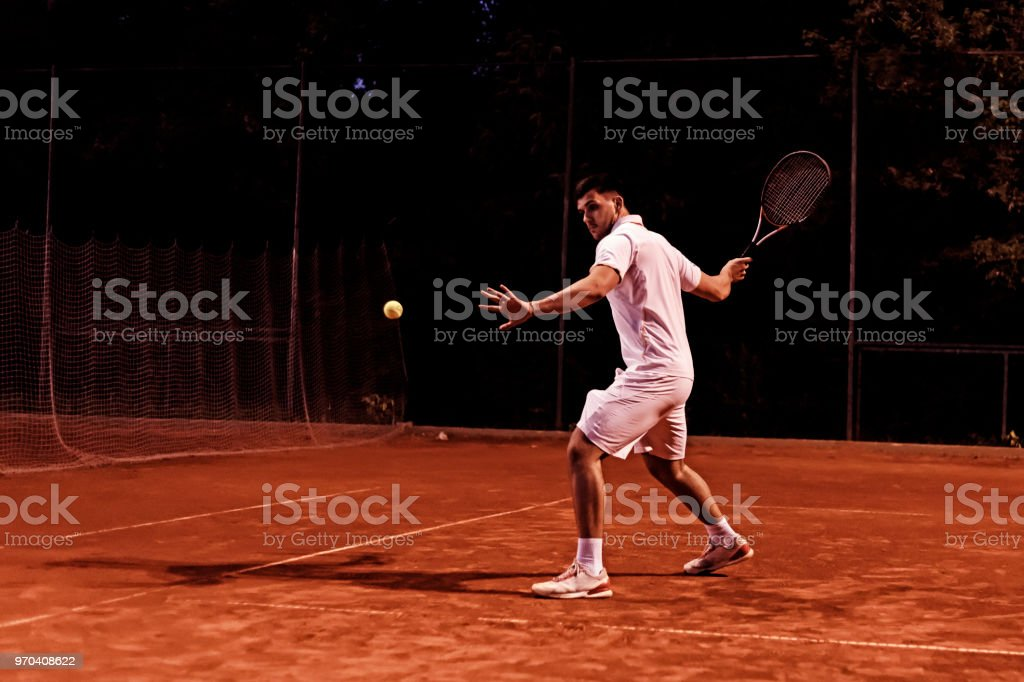 Tennis player at clay court during match stock photo