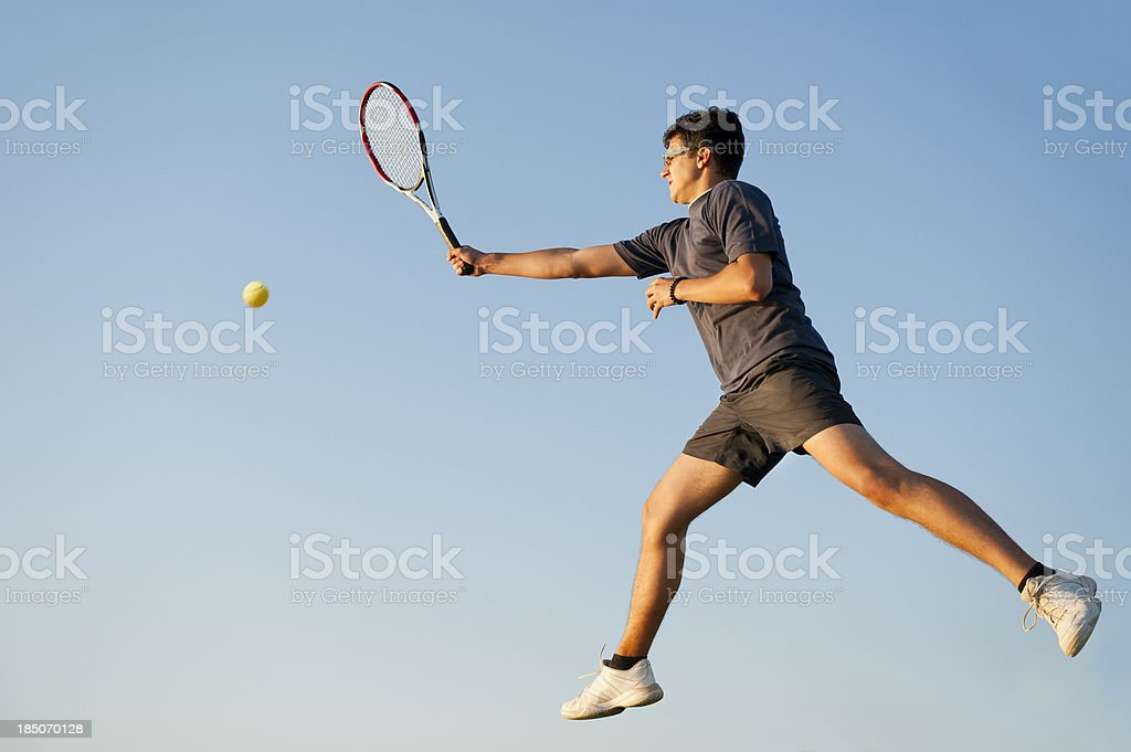Tennis player at forehand volley royalty-free stock photo