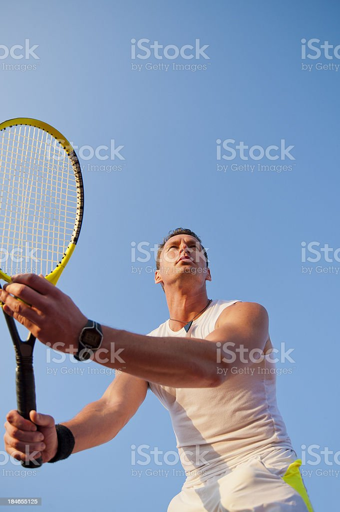 Tennis player at service stock photo