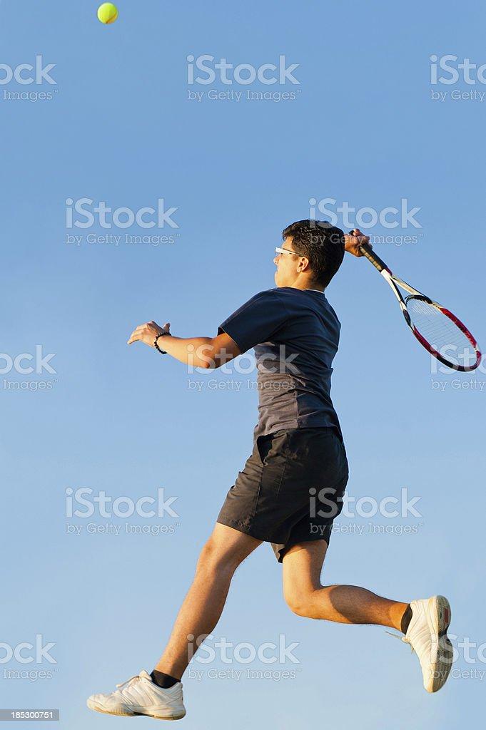 Tennis player at smash stock photo