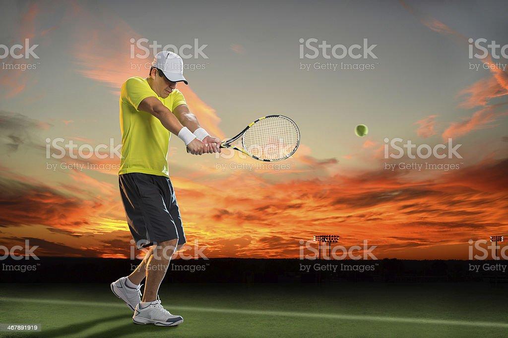 Jugador de tenis en la puesta de sol - Foto de stock de Actividad libre de derechos