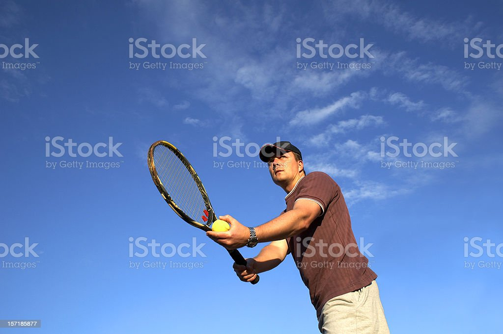 Tennis player before serve royalty-free stock photo