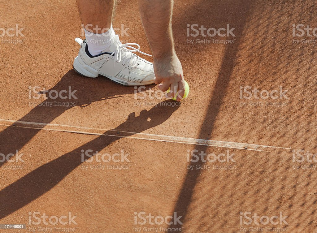 tennis player gets the ball royalty-free stock photo