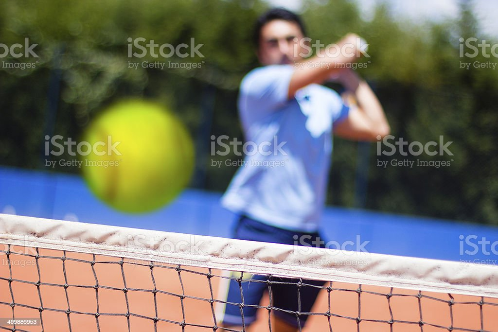 Tennis player hit the ball royalty-free stock photo
