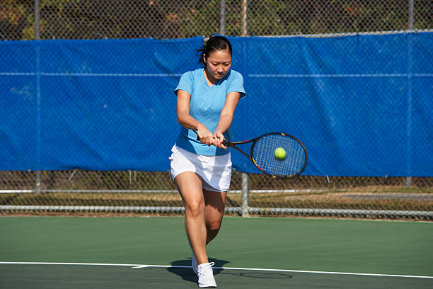 Tennis player hitting backhand stock photo