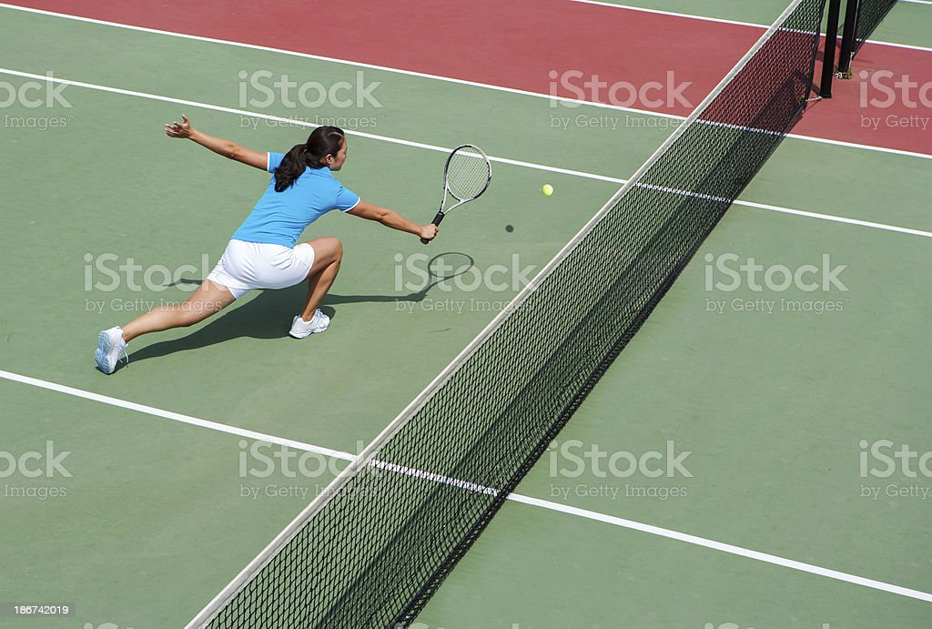 Tennis player hitting backhand volley stock photo