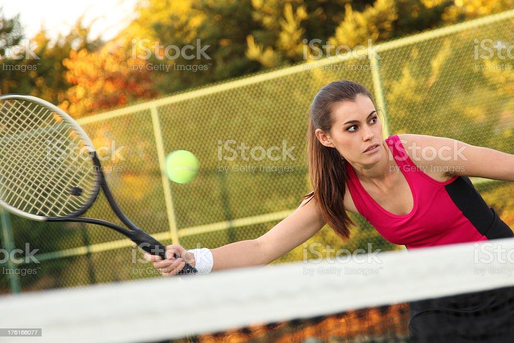 Tennis Player Hitting Ball royalty-free stock photo
