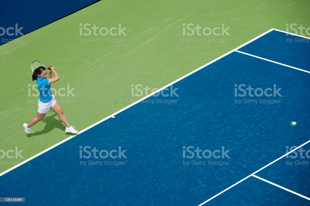 Tennis player hitting forehand royalty-free stock photo