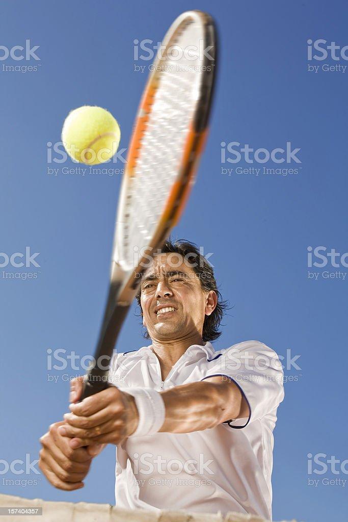 Tennis player hitting the ball stock photo