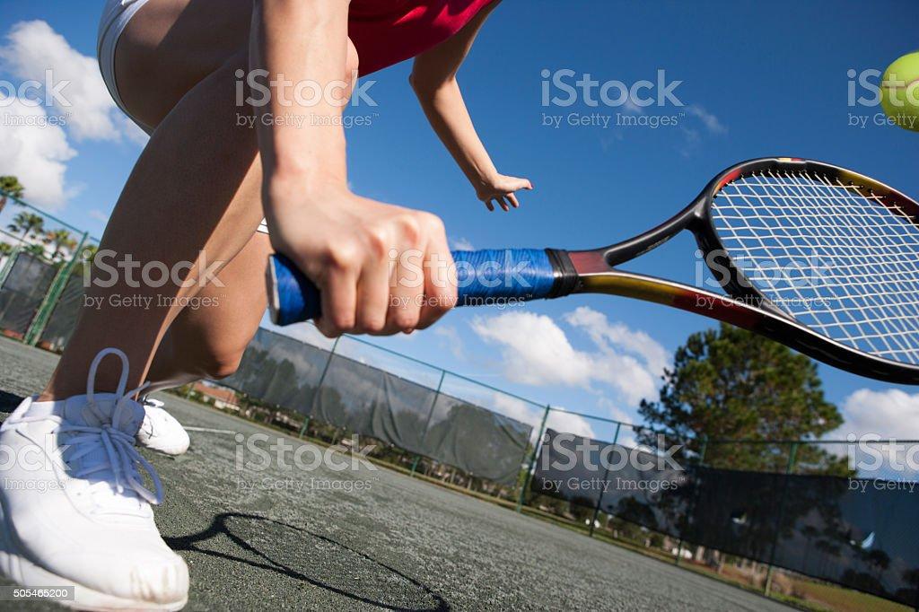 Tennis player hitting volley on har-tru tennis court stock photo