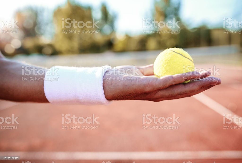 Tennis. Player holding ball in his hand. Sport, recreation concept stock photo