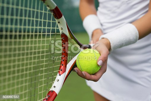 istock Tennis player holding racket and ball in hands 503392332