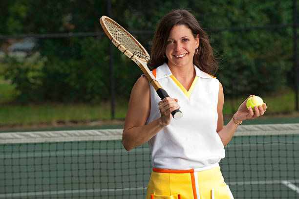 Tennis player in a vintage outfit stock photo