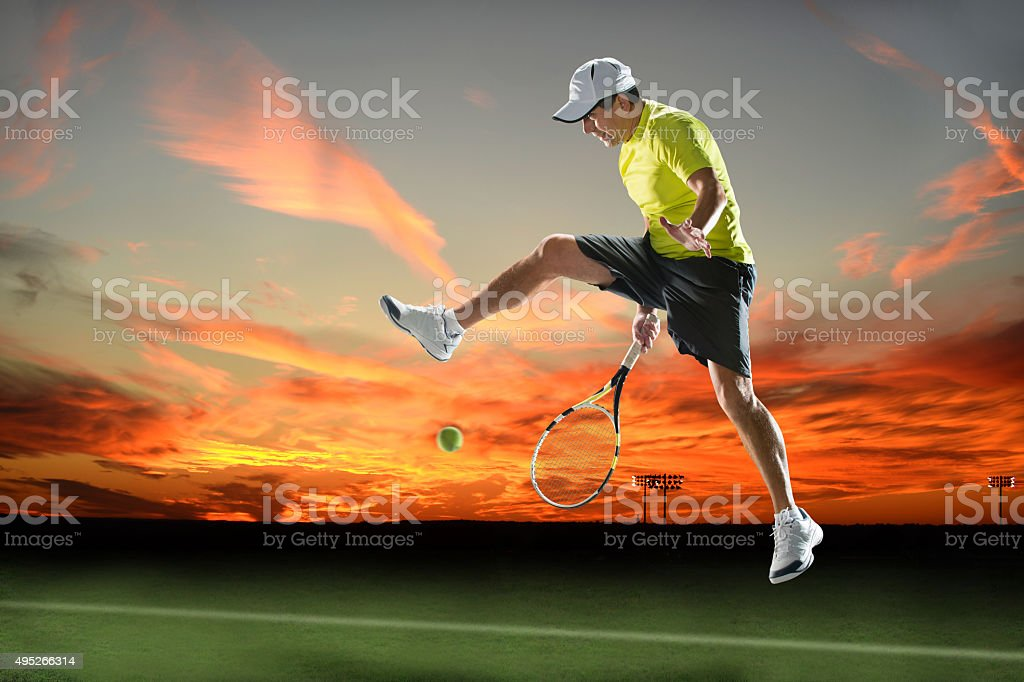 Tennis Player in Action at Sunset stock photo