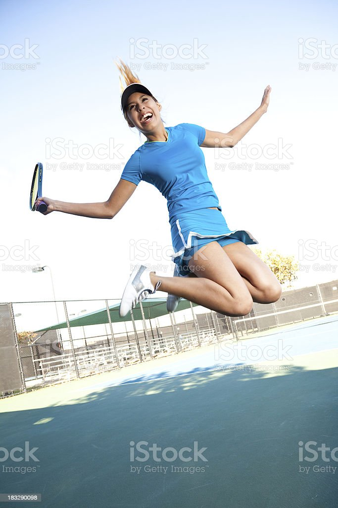 Tennis Player Jumping in the Air With Excitement royalty-free stock photo