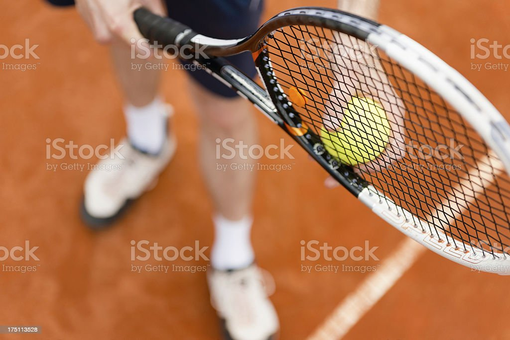 Tennis player on serve royalty-free stock photo