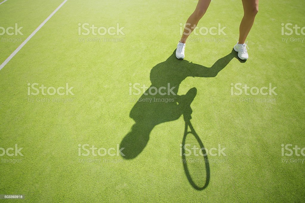 Tennis player on the court stock photo