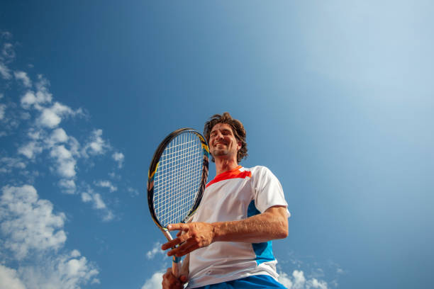 Tennis player portrait from lower narrow angle stock photo