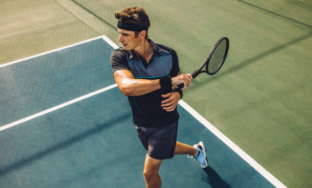 Tennis player practicing forehands stock photo