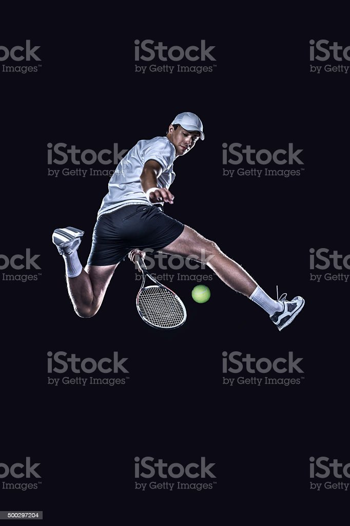 Tennis player reaching for the hard ball isolated stock photo