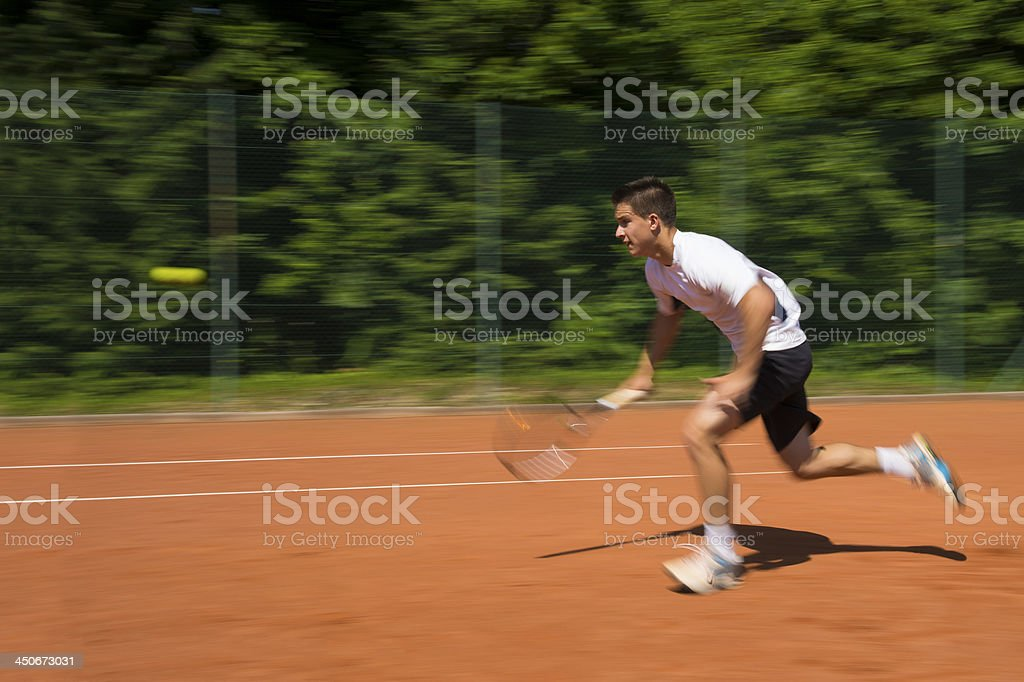 Tennis Player running to catch the ball royalty-free stock photo