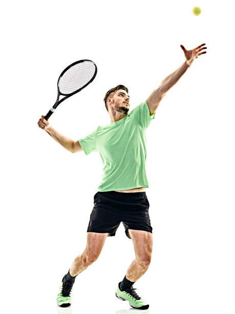 tennis player service serving man isolated - tennis stock photos and pictures