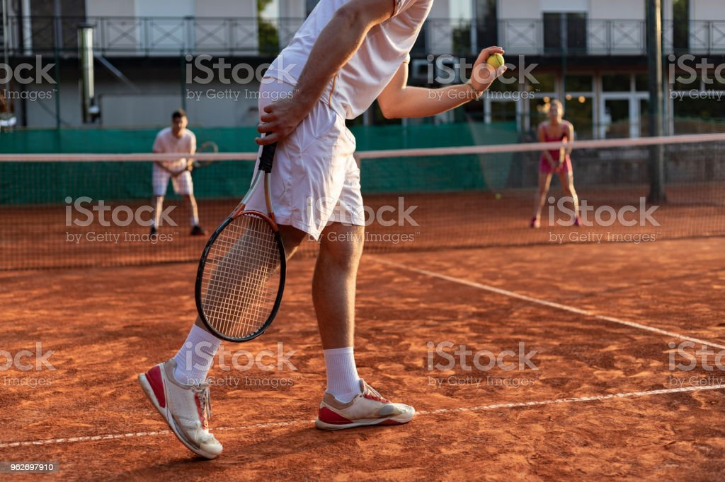 tennis player serving outdoor stock photo