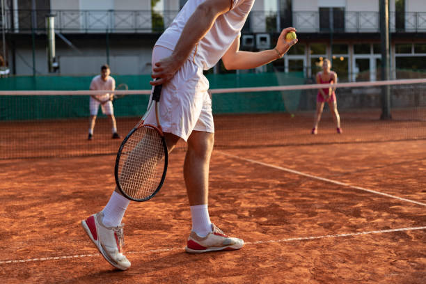 tennis player serving outdoor - tennis stock pictures, royalty-free photos & images